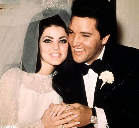 Elvis and Priscilla Presley on their wedding day