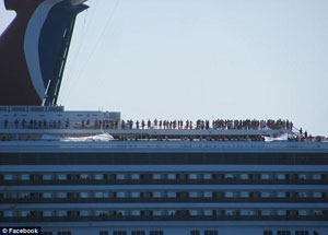 Passengers wait on deck for Carnival Triumph's arrival into Mobile, Alabama. Image: dailymail.co.uk