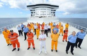 SES volunteers take prime position aboard QM2.Image: Carnival Australia