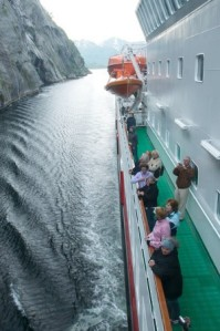 Kong Harald sails through the narrowTrollfjord, Norway. Image: Hurtigruten