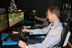 Sture Myrmell - Carnival Australia vice president hotel operations takes on Carnival Australia entertainment manager David Druery on the new V8 simulators onboard Pacific Pearl. Photo Credit: Carnival Australia