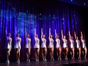 The Rockettes help christen their ship. Photo Credit: Dimitrios Kambouris, Getty Images for Norwegian Cruise Line