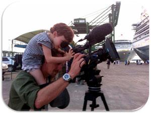Simon's daughter Uma helps film the Queen Elizabeth